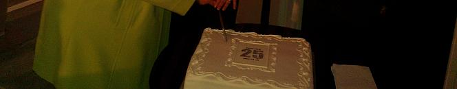 Baroness Rennie Fritchie and Nominet CEO Lesley Cowlie cut Nominet's 25th Birthday Cake