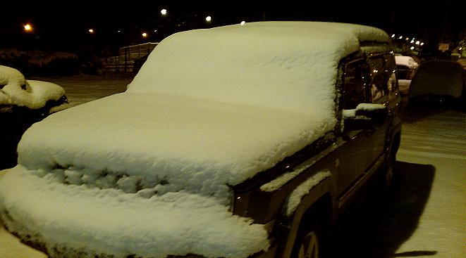 snow covereed jeep at Newark Northgate railway station last night