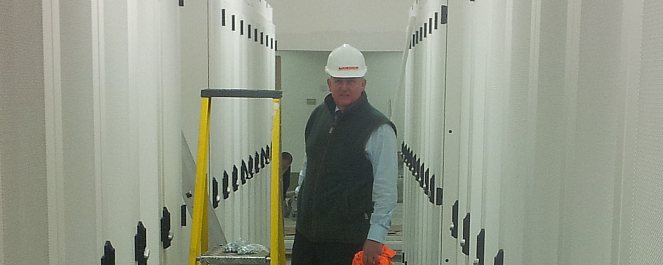 Tim Radford inspects a row of racks in the Timico data centre