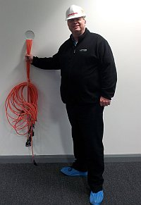 Tref holding some cables at the Timico Newark data centre