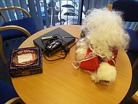 hmm, whats this, a tin containing mince pies, a Santa outfit and a Cisco router on someone's desk!