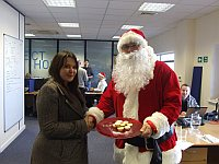 Fiona Spear - winner of the Timico mince pie competition is congratulated by Santa himself