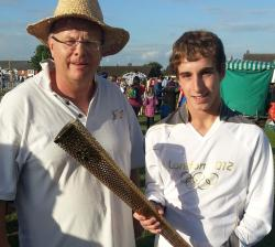 tref with Olympic torch in Lincoln
