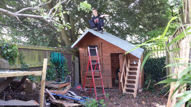 kid3 on top of shed