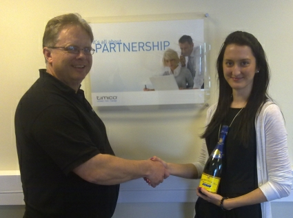 Trefor Davies presents Gemma Barsby with a bottle of champagne for passing the Cisco sales examination