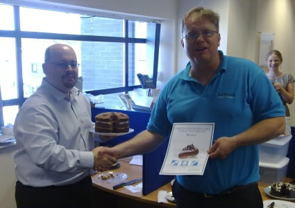 """Andrew massing (left) is presented with his certificate for """"Best Chocolate Cake, 2010"""""""
