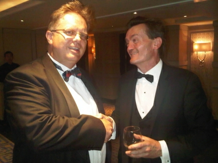Tref shaking hands with CEO of UK MUsic Feargal Sharkey at the ISPA Awards