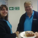 Faye Hemingway is congratulated by Trefor Davies for winning the Timico Lemon Drizzle Cake Competition