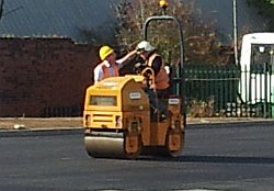 site manager Nigel has a word with the driver of the roller