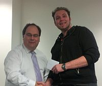 Gareth Bryan - a giant amongst engineers bends down to receive his award from CEO Chris Tombs