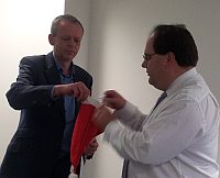 Timico Group Ops Director Calum Malcolm holds the sorting hat whilst CEO Chris Tombs draws the name for the overall winner of the Group Ops Employee of the Year