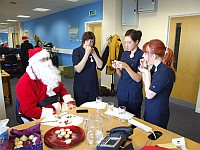 Great care is taken over the judging of the Timico mince pie competition  with Santa looking on