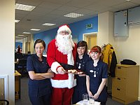 The judges line up for a cuddle with Santa and to tell him what they would like for Christmas