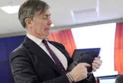 Patrick Mercer MP  swipes iPad to open virtual curtains officially opening the Timico datacentre