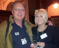Trefor Davies and Timico VoIP Product Manager Gemma Jankiewicz show off the ITSPA Award for Best ITSP (Enterprise)