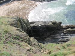 rocks at Fenella Beach seen from the base of Peel Castle