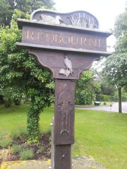 The wooden cross on the green in Redbourne
