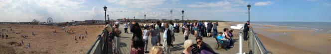 A panoramic view from Skegness pier on a hot and busy day in August