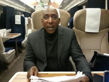 Colin McFarlane speaks his lines to Trefor Davies on the train to London