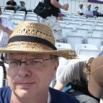 me wearing hat damaged by cricket ball
