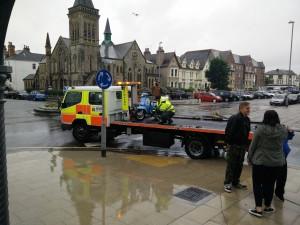 broken scooter in llandudno rain